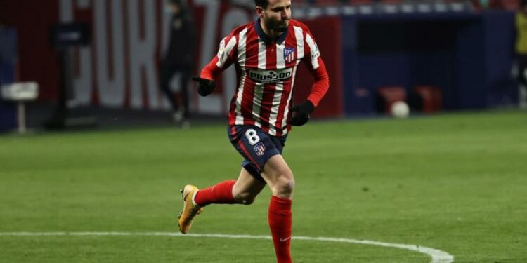 Ekspresi pemain Atletico Madrid, Saul Niguez usai mencetak gol ke gawang Sevilla.