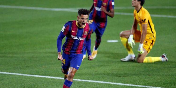 Selebrasi gelandang Barcelona, Philipe Coutinho usah mencetak gol ke gawang Sevilla.