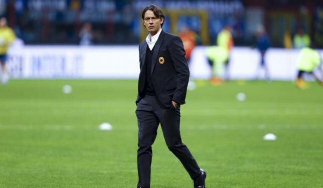 AC Milan's coach Filippo Inzaghi walks on the pitch before their Italian Serie A soccer match against Inter Milan at San Siro stadium in Milan April 19, 2015. REUTERS/Stefano Rellandini