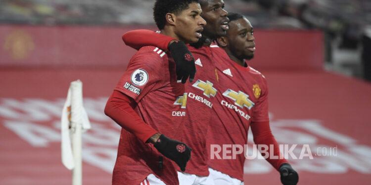 Marcus Rashford dari rekan-rekannya di Manchester United.
