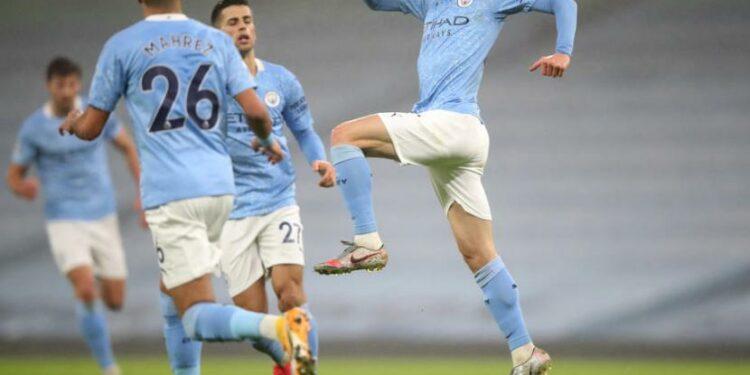 Pemain Manchester City, Phil Foden, melakukan selebrasi