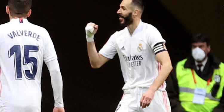 Reaksi Benzema usai menyelamatkan Real Madrid dari kekalahan di kandang Atletico, Senin (8/3) dini hari WIB.
