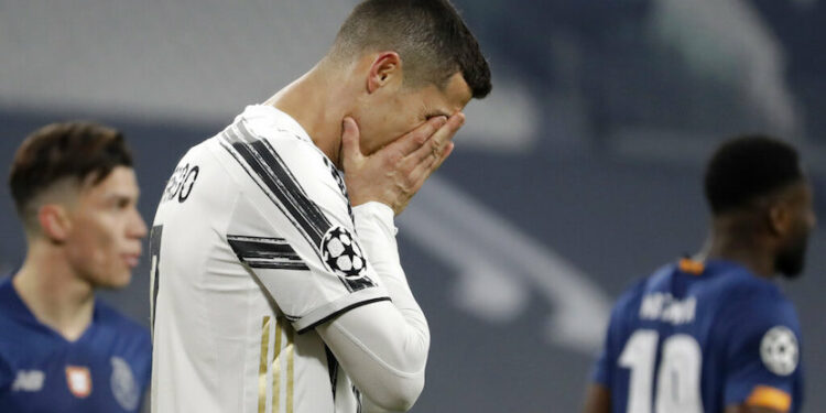 Juventus Cristiano Ronaldo reacts during the Champions League, round of 16, second leg, soccer match between Juventus and Porto in Turin, Italy, Tuesday, March 9, 2021.