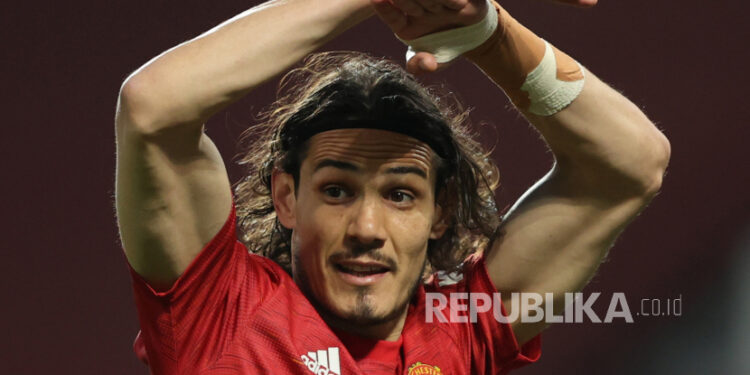 Manchester United's Edinson Cavani reacts during an English Premier League football match between Manchester United and Brighton Hove Albion in Manchester, English, 04 April 2021.