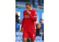 Virgil van Dijk dari Liverpool bereaksi ketika dia meninggalkan lapangan selama pertandingan Liga Premier Inggris antara Everton dan Liverpool di Liverpool, Inggris, 17 Oktober 2020.