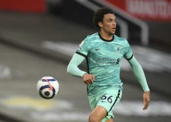 Trent Alexander-Arnold of Liverpool controls the ball during the English Premier League football match between Manchester United and Liverpool, at the Old Trafford stadium in Manchester, English, Thursday, 13 May 2021.