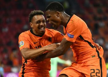 Denzel Dumfries (right) from the Netherlands celebrates with Donyell Malen from the Netherlands after scoring his team's second goal during the UEFA EURO . UEFA group stage football match 2020 between the Netherlands and Austria in Amsterdam, Netherlands, 17 June 2021.