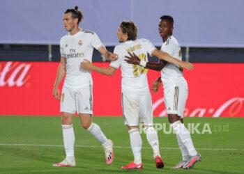 Gareth Bale (kiri) melakukan selebrasi usai mencetak gol beberapa waktu lalu.