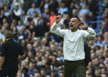 Reaksi pelatih Manchester City Pep Guardiola selama pertandingan sepak bola Liga Primer Inggris antara Manchester City dan Norwich City di stadion Etihad di Kota Manchester, Inggris, Sabtu, 21 Agustus 2021.