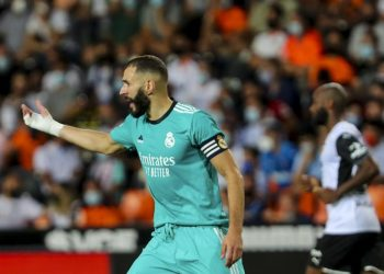 Karim Benzema of Real Madrid celebrates after scoring his team's second goal during the Spanish La Liga football match between Valencia and Real Madrid at the Mestalla stadium in Valencia, Spanish, Sunday, 19 September 2021.