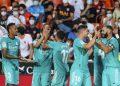 Para pemain Real Madrid merayakan gol selama pertandingan sepak bola La Liga Spanyol antara Valencia dan Real Madrid di Stadion Mestalla di Valencia, Spanyol, Ahad, 19 September 2021.