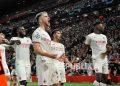Pemain AC Milan Brahim Diaz, tengah, merayakan dengan rekan setimnya setelah mencetak gol kedua timnya pada pertandingan sepak bola Grup B Liga Champions antara Liverpool dan AC Milan di Anfield, di Liverpool, Inggris, Kamis (16/9) dini hari WIB.