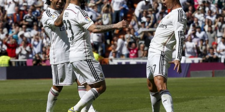 Real Madrids Cristiano Ronaldo (R) celebrates with teammates Marcelo (L) and Francisco Isco Alarcon after a goal against Eibar during their Spanish first division soccer match at Santiago Bernabeu stadium in Madrid April 11, 2015